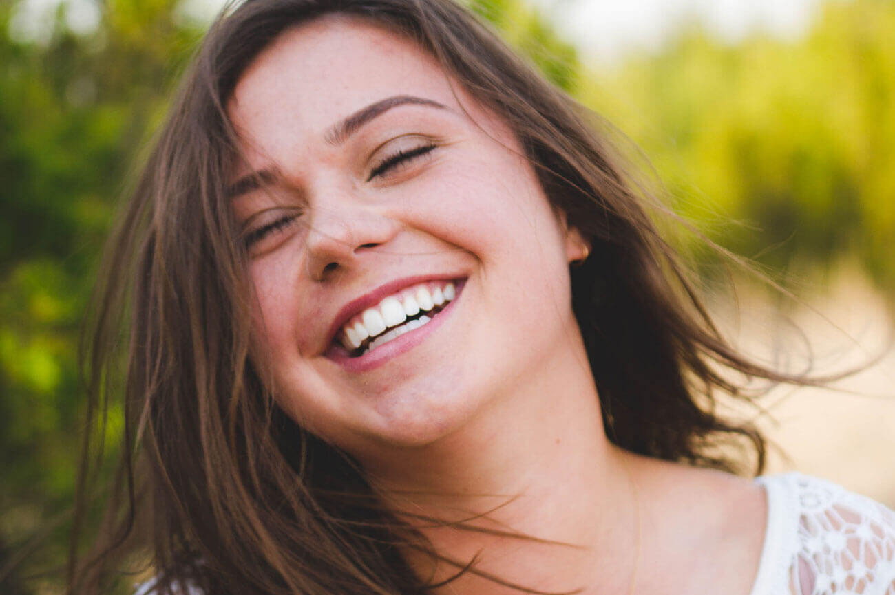 Woman with brown hair smiling.