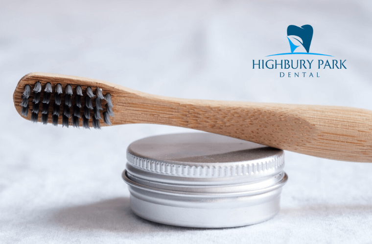 Bamboo toothbrush sits on top of metal container